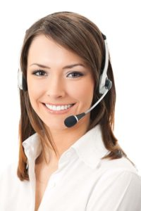 Friendly smiling women with brown hair and headset on.