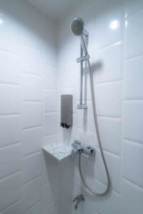 Inside of shower showing new tiles and silver shower head